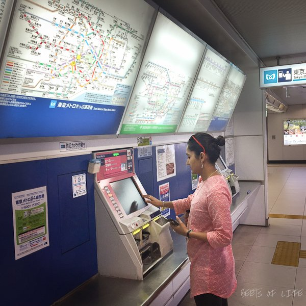 Buying train tickets at a station in Tokyo