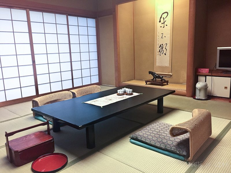 Ryokan in Hakone - multi-purpose room. TV, living, dining, and recreation room all rolled in to one.